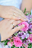 Bridal bouquet and hands with rings Royalty Free Stock Image