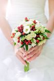 Bridal bouquet in hands Royalty Free Stock Photos