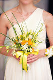 Bridal bouquet in the hands of. Yellow bridal bouquet in the hands of Stock Photos