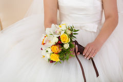Bridal bouquet in the hands of. Yellow bridal bouquet in the hands of Stock Images