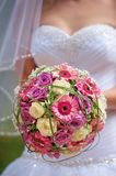 Bridal bouquet. Held by the bride Stock Photo
