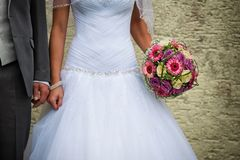 Bridal bouquet. Held by the bride next to her groom Royalty Free Stock Images