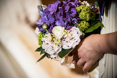 Bridal bouquet. Holding by bridesmaid Stock Photo