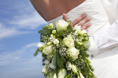 Bridal bouquet and hugging Stock Photography