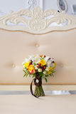 Bridal bouquet in an interior. Delicate bouquet of the bride on a beige couch in a classic interior Stock Photography