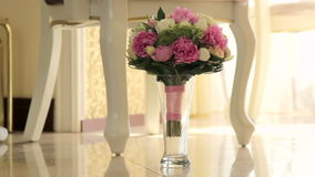 Bridal bouquet in an interior room.Wedding bouquet in a vase on the floor.Wedding interior. stock footage