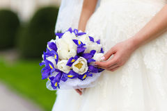 Bridal bouquet. irises and white tulips. Stock Images