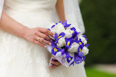 Bridal bouquet. irises and white tulips. Royalty Free Stock Photography