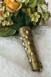 Bridal Bouquet. The bridal bouquet laying on the wedding gown Stock Image