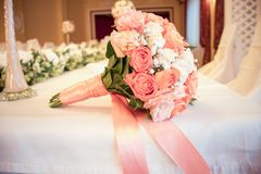 The bridal bouquet lies on royalty free stock image