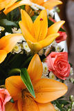 Bridal bouquet of lilies and roses at a wedding party Stock Images