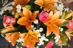 Bridal bouquet of lilies and roses at a wedding party Royalty Free Stock Photography