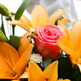 Bridal bouquet of lilies and roses at a wedding party Stock Image