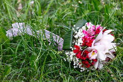 Bridal bouquet of lilies and roses at a wedding party Royalty Free Stock Photos