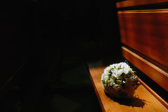 Bridal bouquet lying on the bench Stock Images