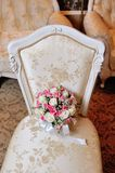 Bridal bouquet lying on the chair Royalty Free Stock Photo