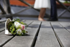 Bridal bouquet lying on the floor Royalty Free Stock Photos
