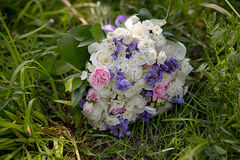 Bridal bouquet lying on the grass Stock Photography