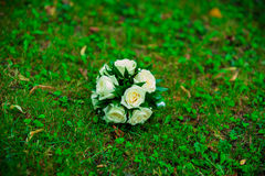 bridal bouquet lying on the grass stock photo