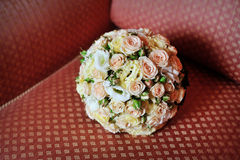 Bridal bouquet lying on the sofa Royalty Free Stock Images