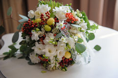 Bridal bouquet lying on the table Royalty Free Stock Photography