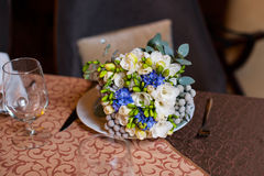 Bridal bouquet lying on the table Royalty Free Stock Photo