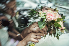 Bridal bouquet. In newlywed`s hands Stock Image