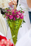 Bridal bouquet. Nonstandard bridal bouquet among white dresses Royalty Free Stock Photography