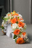 Bridal bouquet with orange roses and butterfly Royalty Free Stock Photo