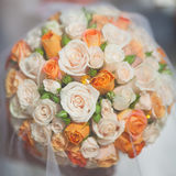 Bridal bouquet with orange and white roses Stock Image