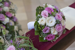 Bridal bouquet on the pew Stock Photography