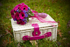 Bridal bouquet on a picnic basket Royalty Free Stock Image