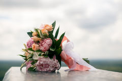 Bridal bouquet from pink pions and roses. Wedding bouquet from pink pions and roses Stock Image