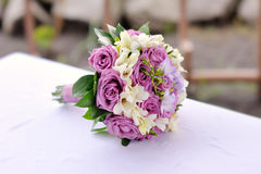 Bridal bouquet of purple roses Royalty Free Stock Photography