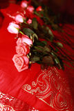 Bridal Bouquet on a red bed Royalty Free Stock Photos