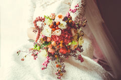 Bridal bouquet. With red and burgundy flowers royalty free stock photo