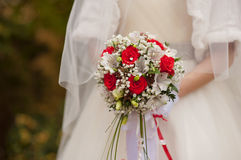 Bridal bouquet of red roses in bride's hands Stock Photos