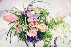 Bridal bouquet with with red roses and purple flowers Royalty Free Stock Photo