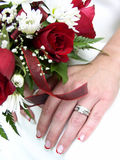 Bridal bouquet and ringed hand. Bride's wedding ring hand and bouquet closeup Royalty Free Stock Photography