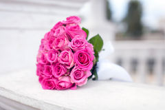 Bridal bouquet of roses on the bench Stock Photo