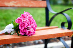 Bridal bouquet of roses on the bench Stock Image