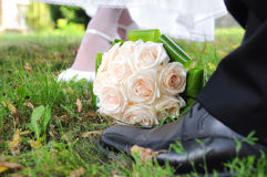 Bridal bouquet of roses with the bride and groom Royalty Free Stock Image