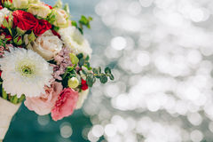 Bridal bouquet of roses and chrysanthemums on a background textu Royalty Free Stock Photography