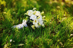 Bridal bouquet of roses on the grass Stock Images