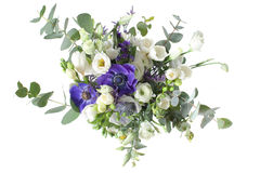 A bridal bouquet of roses and ornamental poppies in the background Stock Images