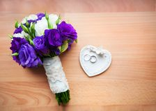 Bridal bouquet of roses, peony and rings Royalty Free Stock Image
