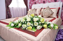 Bridal bouquet of roses, wedding flowers. For the ceremony on the bed Stock Photo