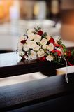Bridal bouquet of roses on a wood table Royalty Free Stock Photography