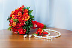Bridal bouquet of roses on a  wooden planks beads Stock Image