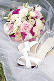Bridal bouquet with shoes Royalty Free Stock Image